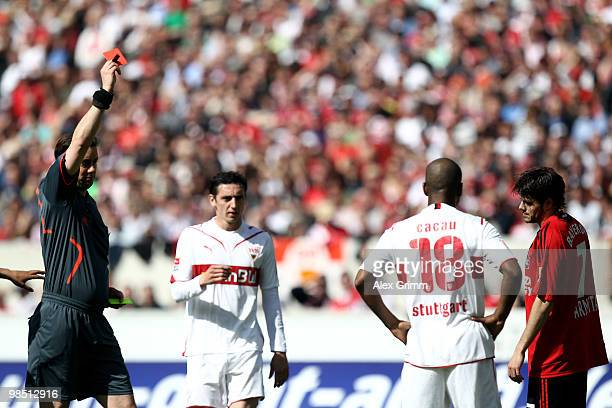 Tranquillo Barnetta of Leverkusen is sent off by referee Manuel Graefe during the Bundesliga match between VfB Stuttgart and Bayer Leverkusen at the...