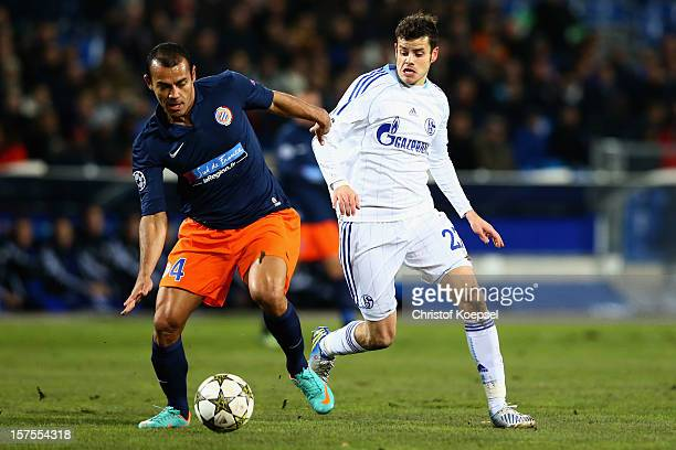 Tranquillo Barnetta of Schalke challenges Vitorino Hilton of Montpellier during the UEFA Champions League group B match between Montpellier Herault...