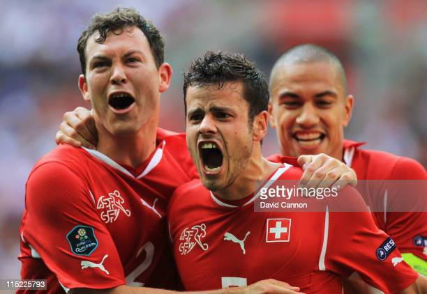 Tranquillo Barnetta of Switzerland celebrates scoring the first goal with teammates during the UEFA EURO 2012 group G qualifying match between...