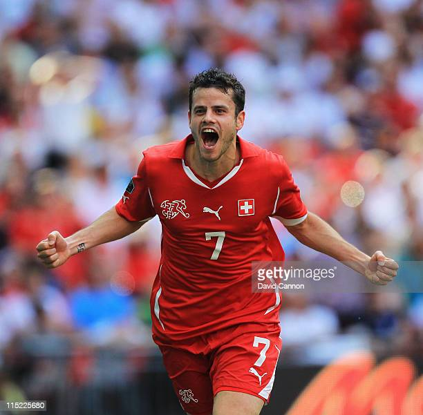 Tranquillo Barnetta of Switzerland celebrates scoring the second goal during the UEFA EURO 2012 group G qualifying match between England and...