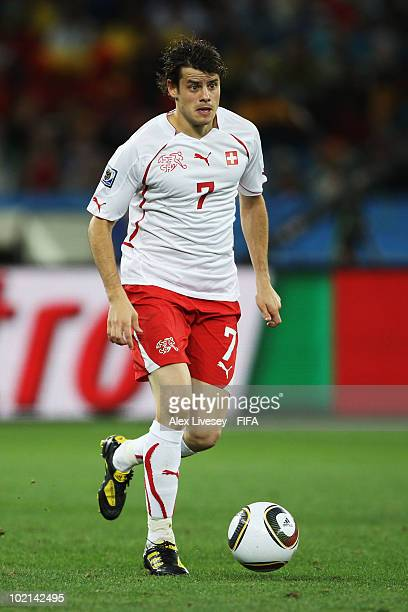 Tranquillo Barnetta of Switzerland runs with the ball during the 2010 FIFA World Cup South Africa Group H match between Spain and Switzerland at...