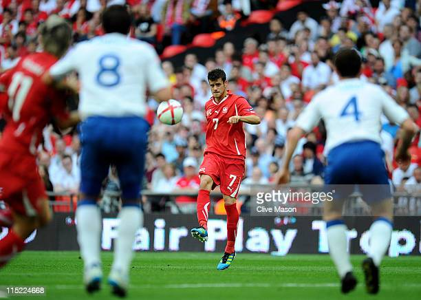 Tranquillo Barnetta of Switzerland shoots to score the first goal during the UEFA EURO 2012 group G qualifying match between England and Switzerland...