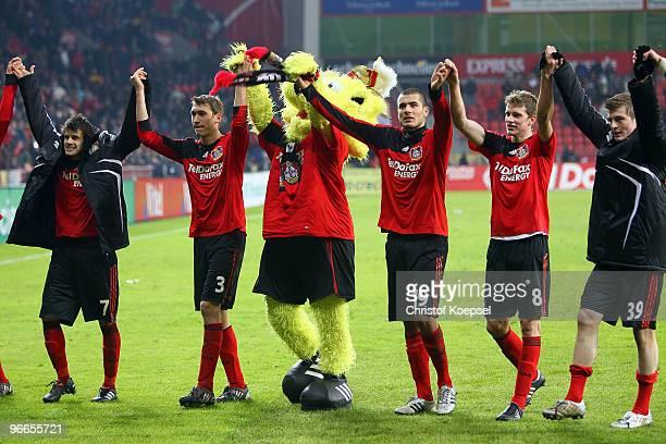 Tranquillo Barnetta, Stefan Reinartz, mascot Brian the Lion, Eren Derdiyok, Lars Bender and Toni Kroos of Leverkusen celebrate the 2-1 victory after...