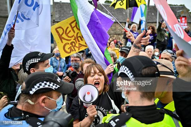 Trans Rights activists hold a counter demonstration next to a woman's rights demo organised by Women Wont Wheesht on September 02, 2021 in Edinburgh,...