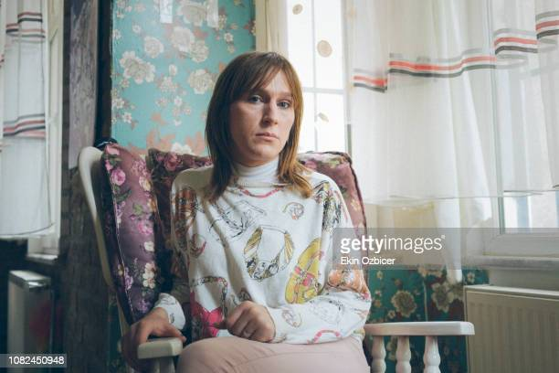 trans woman sitting on a rocking chair - transexual stock photos and pictures