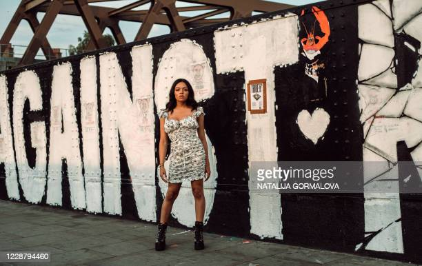 Trans woman Alexis Meshida poses for a portrait on Brick Lane in London on September 15 during an interview with AFP about her struggle to get gender...