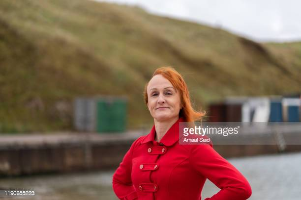 trans woman at the seaside - grampian scotland stock pictures, royalty-free photos & images