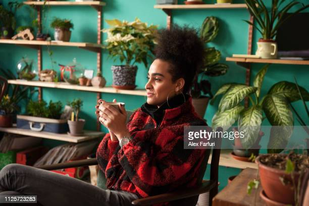 trans woman on her coffee break - showus stock pictures, royalty-free photos & images