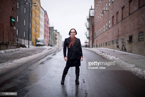 Trans woman outdoors in snowfall in Sweden in the winter