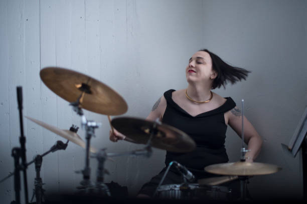 Trans woman playing drums