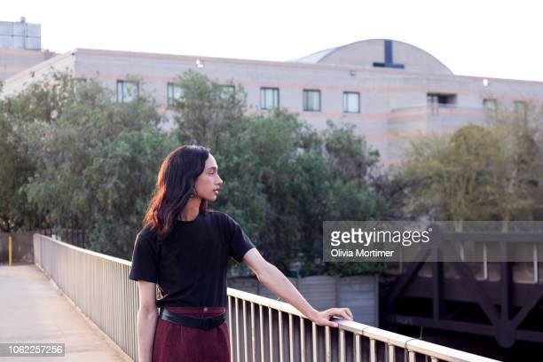 Woman standing on a bridge in the city