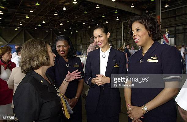Trans World Airlines manager of Flight Services Peggy Horlbert left talks with American Airlines flight attendants left to right Rita Hughey Delores...