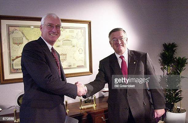 Trans World Airlines president and chief executive officer William Compton left and Bob Baker vice chairman of American Airlines shake hands after a...