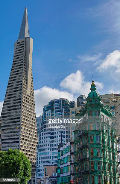 Transamerica Pyramid and Columbus Tower with passing airplane
