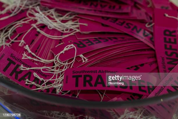 Transfer tags at the Southwest Airlines check-in area at Oakland International Airport in Oakland, California, U.S., on Tuesday, Jan. 19, 2021....
