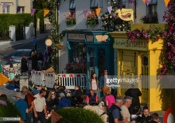 Transformed facades of local shops and flower-decorated homes in the center of Enniskerry in County Wicklow. There are only two more days until...