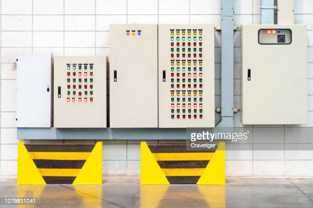 transformer and control panel in the electrical room of a large warehouse building - electrical box stock pictures, royalty-free photos & images