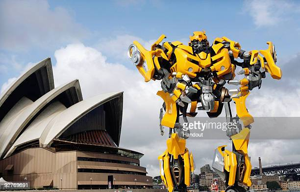 Transformers robot Bumblebee which stands at 5 metres tall and weighs 3 tonnes tours Sydney Harbour by barge to launch the DVD of Transformers...