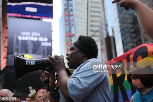 Transgender Army veteran Tanya Walker speaks to protesters in Times Square near a military recruitment center as they show their anger at President...