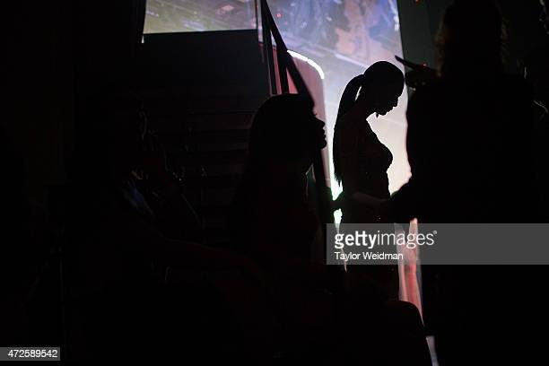A transgender beauty contestant waits to take the stage on May 8 2015 in Pattaya Thailand The Miss Tiffany's Universe transgender beauty contest has...