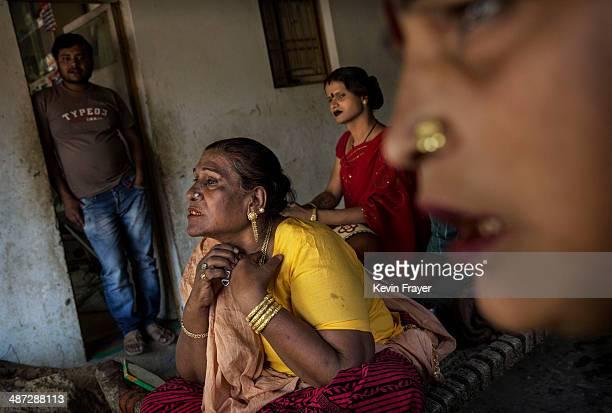 Transgender Candidate Hijra Guru Baseer Kinnar aka Kamala Kinnar center uses a tool to remove facial hair before campaigning in a Muslim...