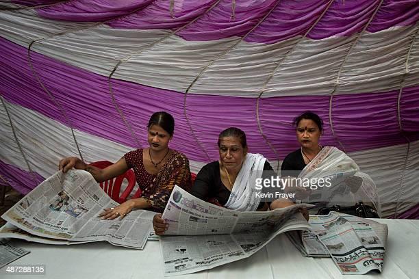 Transgender Candidate Hijra Guru Baseer Kinnar aka Kamala Kinnar center and disciples read newspapers after a press conference on April 21 2014 in...