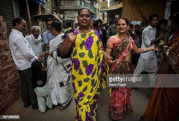 Transgender Candidate Hijra Guru Baseer Kinnar aka Kamala Kinnar left speaks to a resident as disciples walk in front while campaigning in a Muslim...