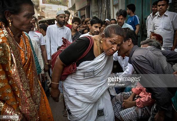 Transgender Candidate Hijra Guru Baseer Kinnar aka Kamala Kinnar listens to a resident while campaigning in a Muslim neighbourhood on April 23 2014...