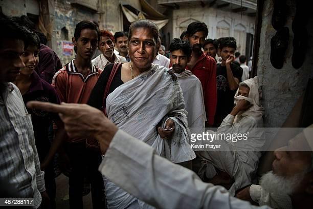 Transgender Candidate Hijra Guru Baseer Kinnar aka Kamala Kinnar speaks to a resident while campaigning in a Muslim neighbourhood on April 23 2014 in...
