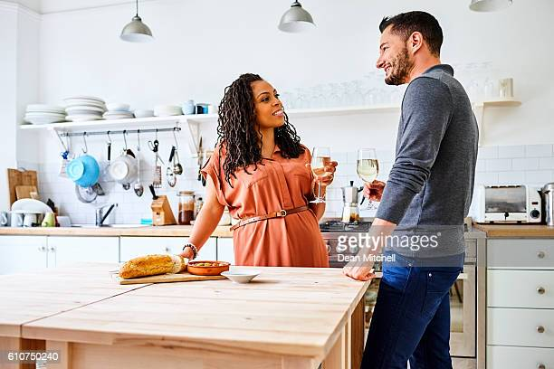 transgender couple drinking wine in kitchen - black transgender stock pictures, royalty-free photos & images