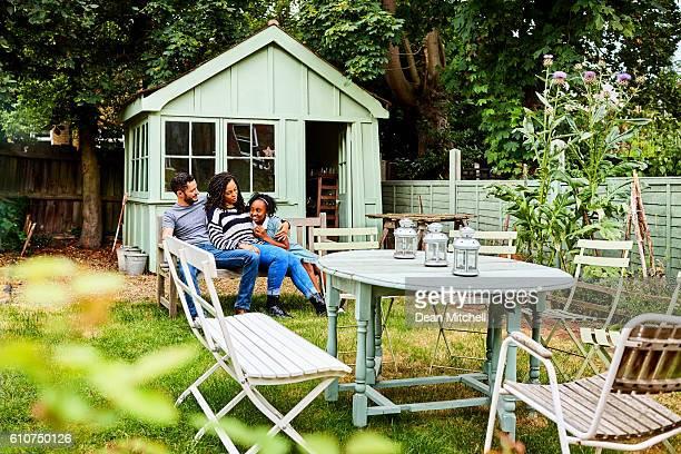 Transgender family sitting together in backyard