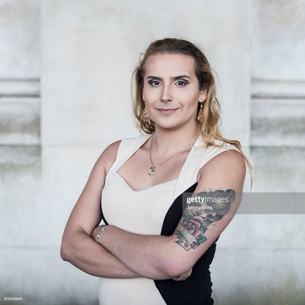 Transgender Female With Tattoo On Arm Looking Towards