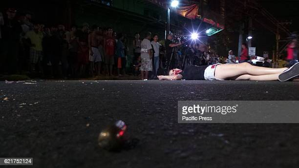 A transgender found dead in Singalong cor Quirino avenue in Malate Manila Eight bullets of 45mm gun is found on the crime scene Possible angle of...