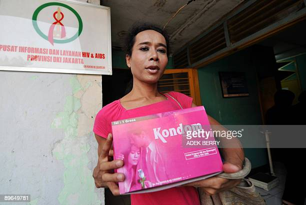 Transgender HIV/AIDS activist Melly holds a box of condoms at a clinic in Jakarta on August 7, 2009. India, Indonesia and Pakistan have become key...