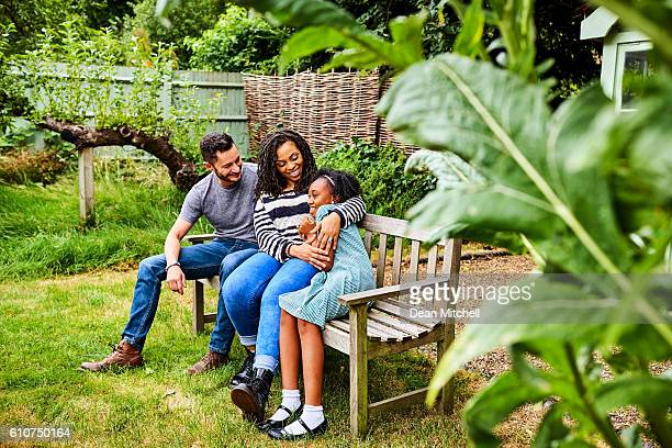 transgender male with his adopted daughter and wife in backyard - black transgender stock pictures, royalty-free photos & images