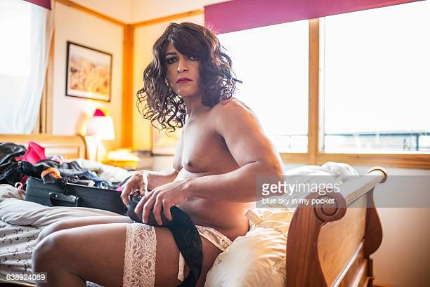 A transgender man in the bedroom