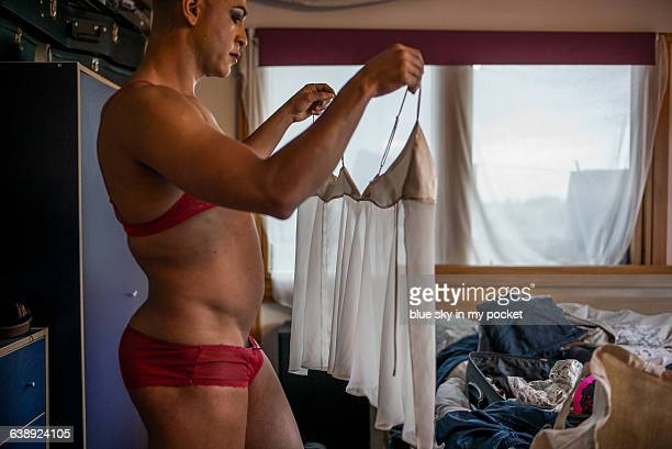 a transgender man in the bedroom - cross dressing stock pictures, royalty-free photos & images