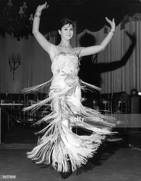 Model April Ashley during her song and dance act at the Astor Club London Miss Ashley was born George Jamieson in Liverpool in 1935 and underwent a...
