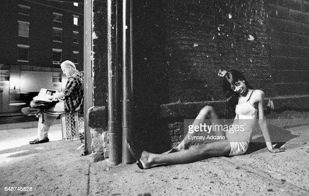 A transgender prostitute poses on the street in the West Village of New York City in 1999