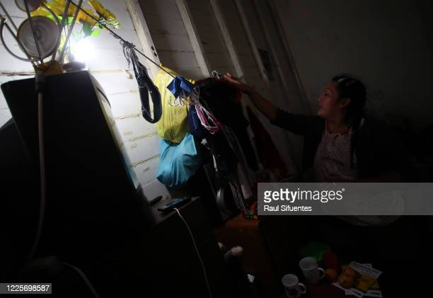 Transgender sex worker Luciana hangs her clothes to dry on July 8 2020 in Lima Peru A group of 8 to 10 transgender sex workers share a house in the...