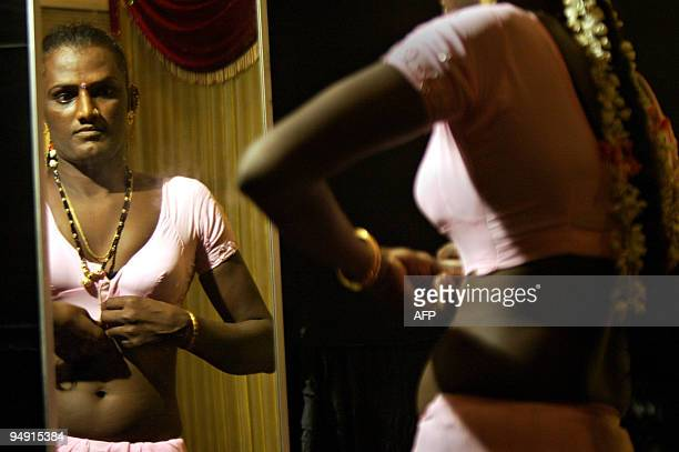 A transgendered person dresses backstage during the Miss India Transgender pageant in Chennai on December 19 2009 More than 100 hopefuls walked the...