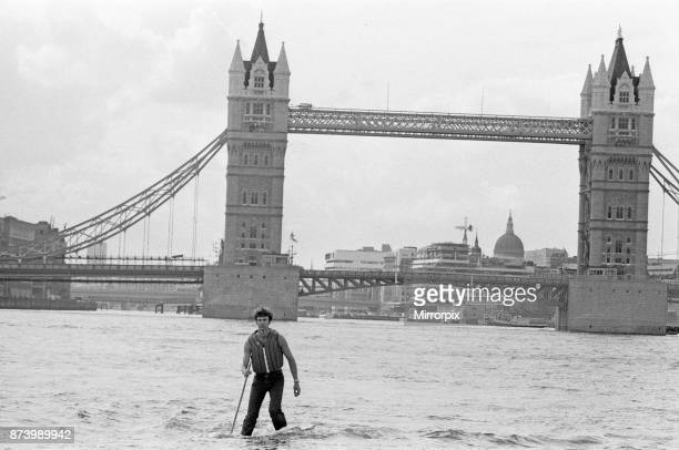 Transglobe expedition leader Sir Ranulph Fiennes walks across the River Thames near Tower Bridge, using Jesus Boots, a pair of floats which have been...