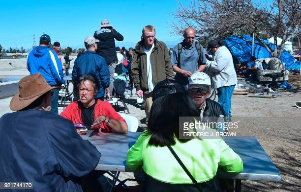 Transients from the homeless encampment beside the Santa Ana River meet with county officials on February 20 2018 in Anaheim California Officials in...