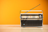 Transistor radio receiver on wood table in home interior 3d