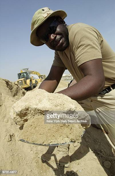 Transit Authority worker Michael Davis of Far Rockaway Queens is busy building bunkers for Marines at Al Jaber Air Base in Kuwait New York City...