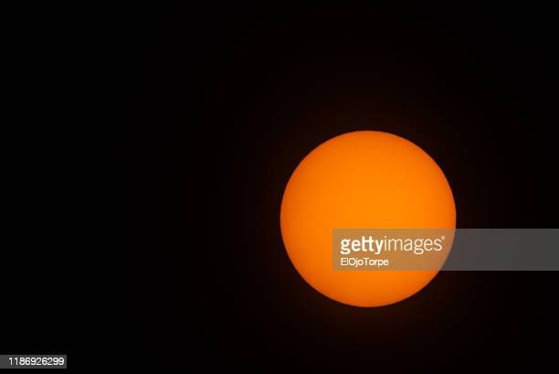 transit of the planet mercury across the sun (bottom right), 11th november 2019, montevideo, uruguay - mercury transit stock photos and pictures