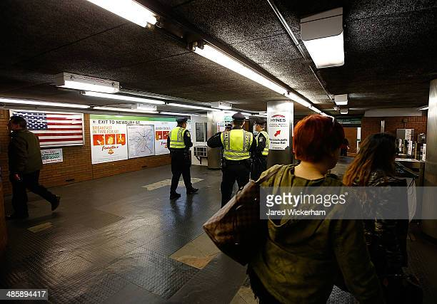 Transit police officers patrol the MBTA Hynes Convention Center station prior to the start of the 2014 BAA Boston Marathon on April 21 2014 in Boston...