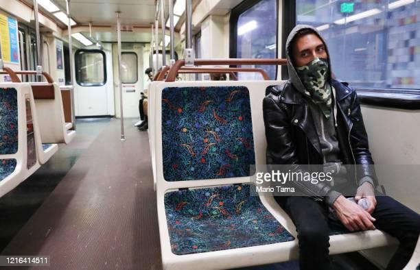 Transit rider Arthur Glover wears a bandana while riding a Los Angeles Metro Rail train amid the coronavirus pandemic on April 1, 2020 in Los...