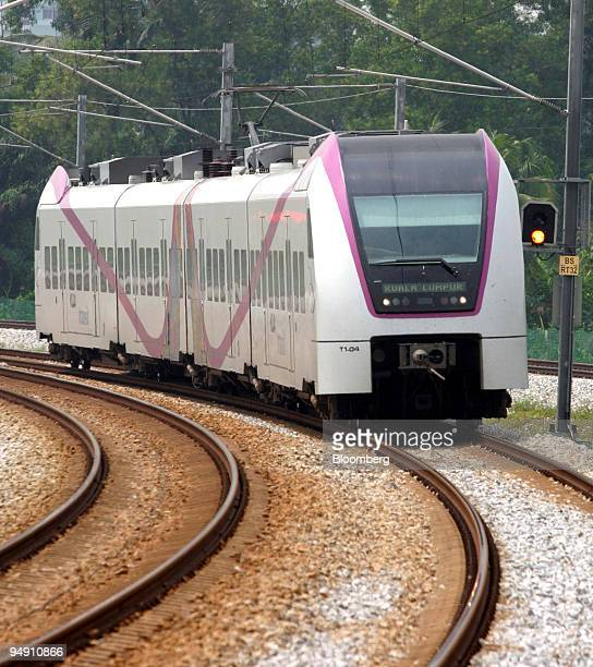 KLIA transit train operated by Express Rail Link Sdn comes into a station on its way to Kuala Lumpur International Airport Monday January 19 2004 in...