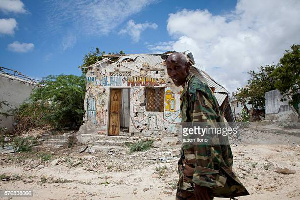 Transitional Federal Government Forces patrol the recently retaken Mogadishu district of Wardhiigley The area had been an Al Shabaab militant...